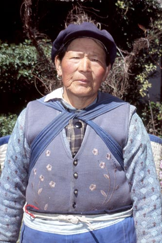 You'll likely be invited for tea by this Naxi woman in Baisha!
