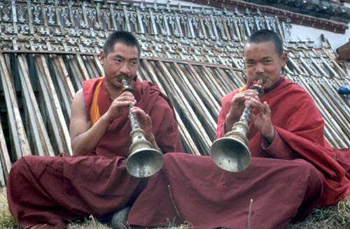 Gyalings are made of ebony and silver with gilt accents and may have decorations of turquoise and coral.